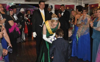 Queen Carolyn receives flowers from Prince Jean-Rose